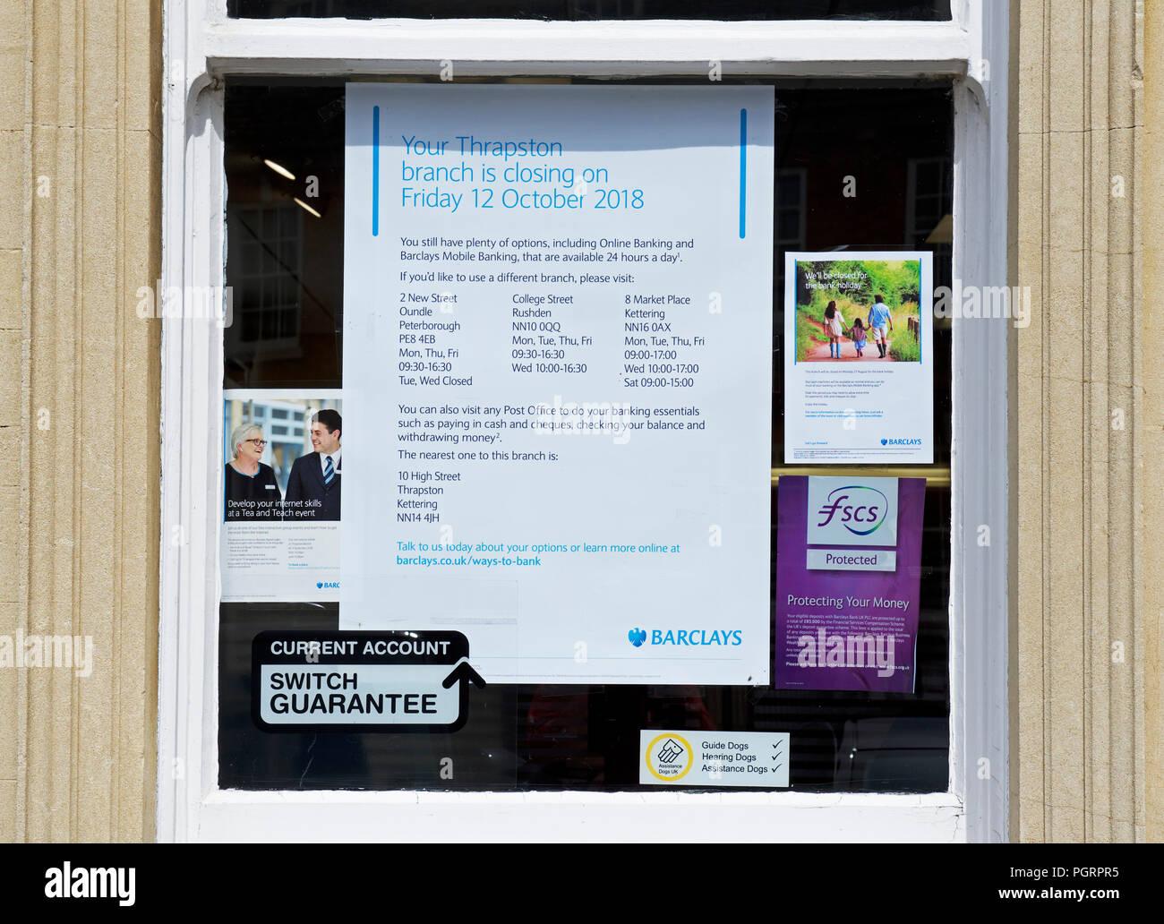 Sign announcing bank closure, Thrapston, Northamptonshire, England UK - Stock Image