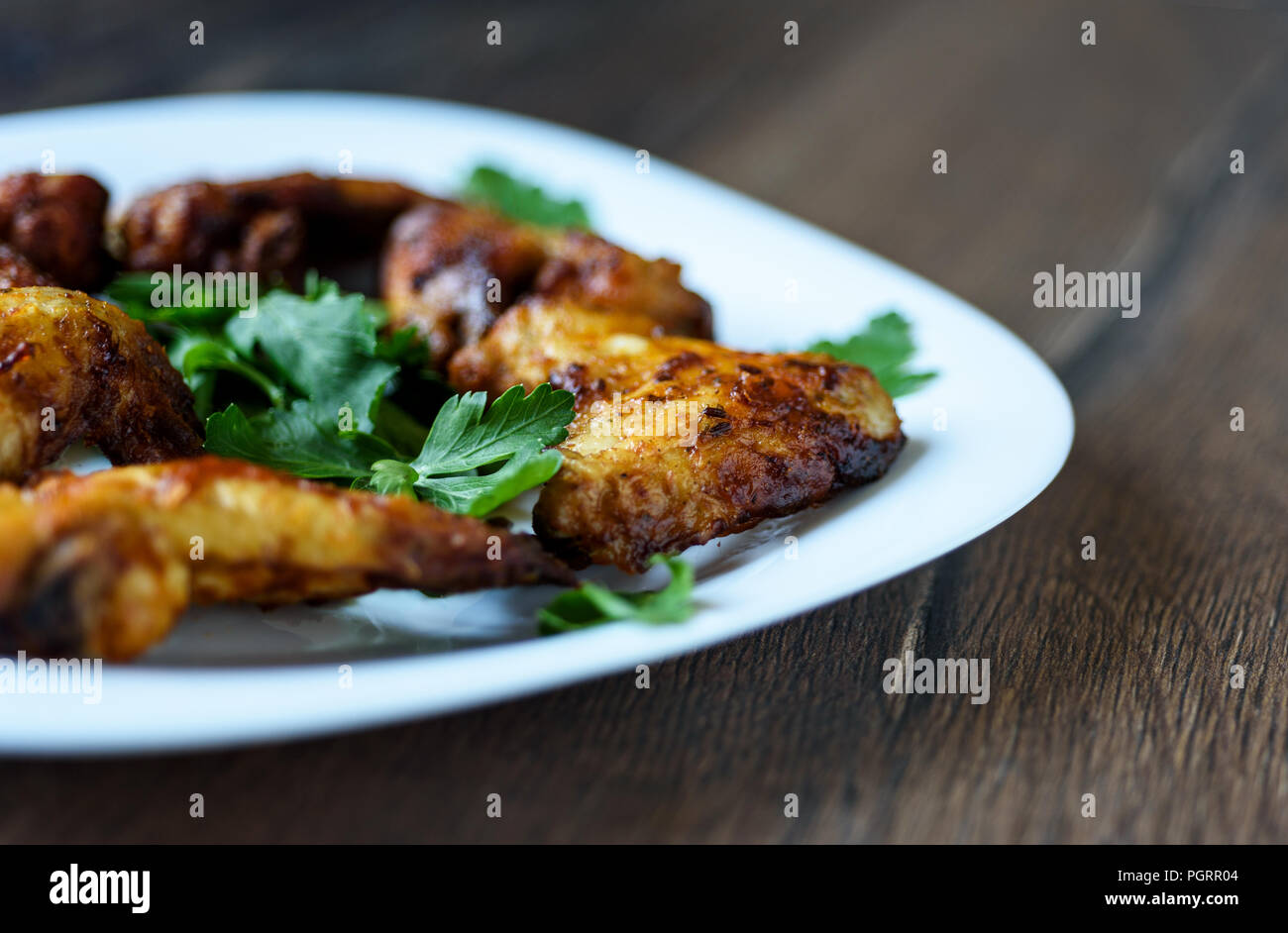 Selective focus. Hot and spicy buffalo chicken wings on a white plate Stock Photo