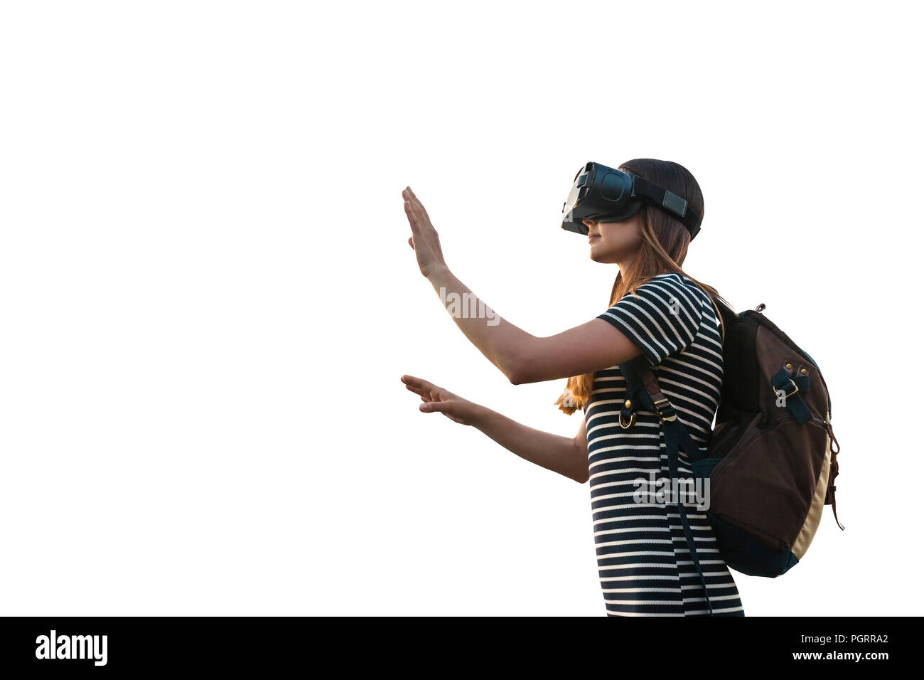Girl with a backpack in virtual glasses is isolated on white background. Virtual travel with the help of new technologies. - Stock Image