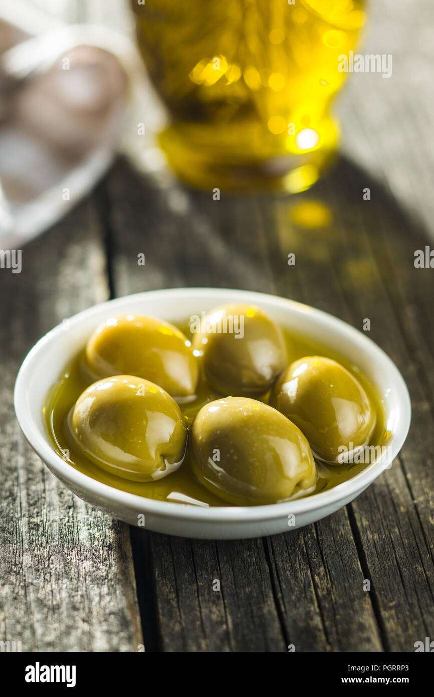 The green olives and olive oil. - Stock Image