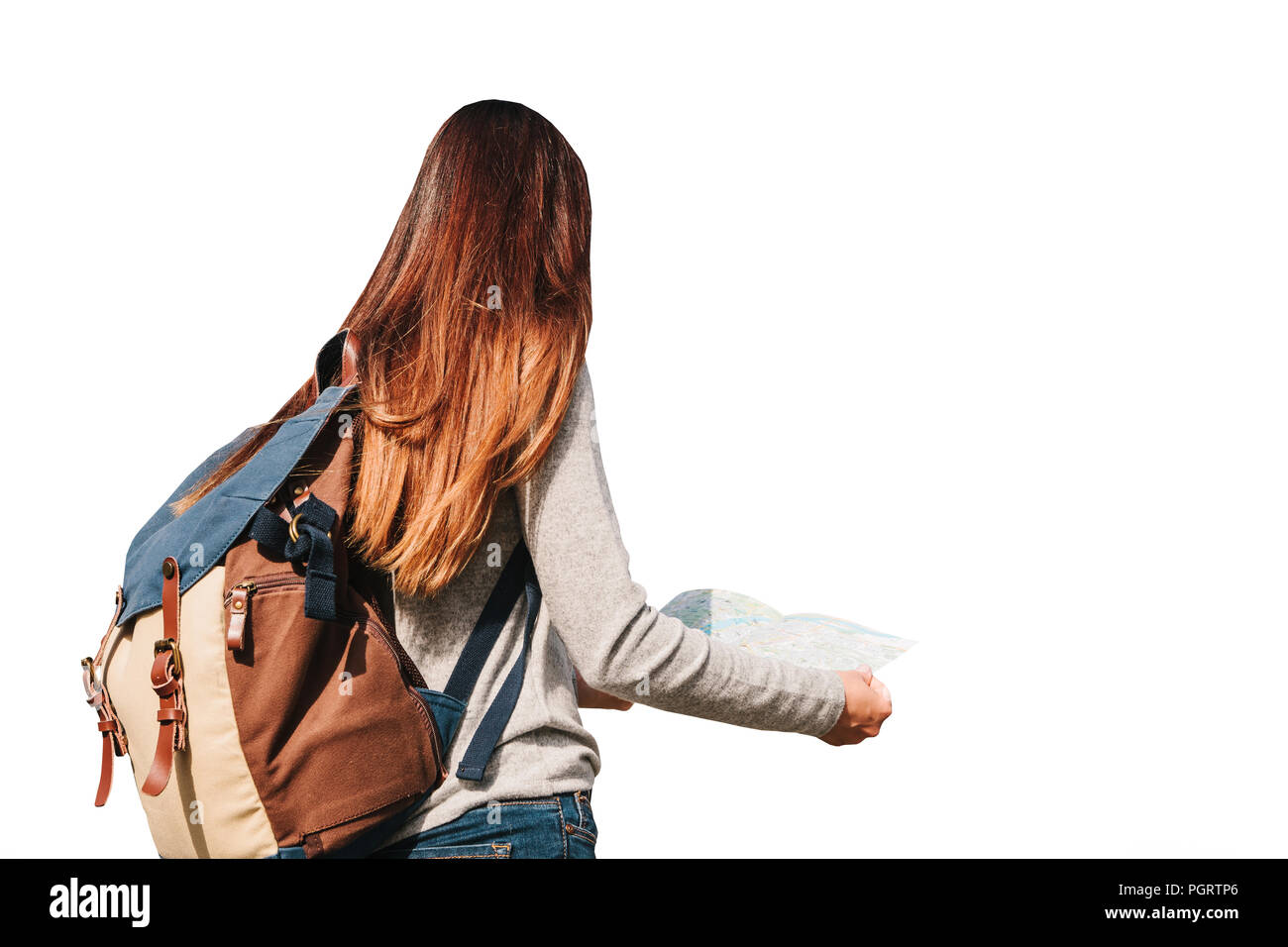 Girl or traveler or tourist with a backpack is looking at a map isolated on white background. - Stock Image