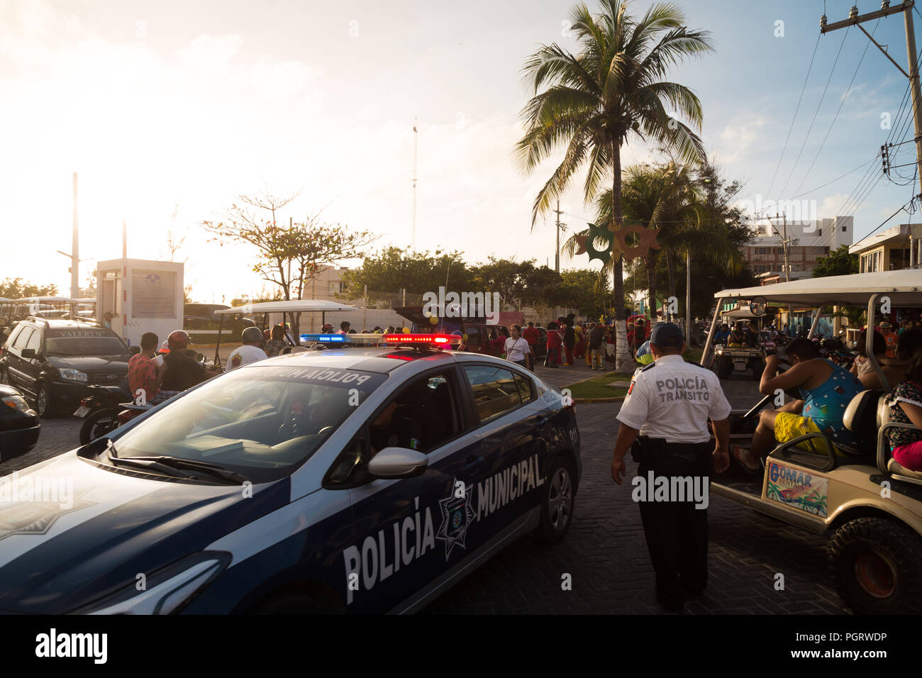 ISLA MUJERES, QR, MEXICO - FEB 11, 2018: Municipal police keep watch over a local festival that was occurring on Isla Mujeres. - Stock Image