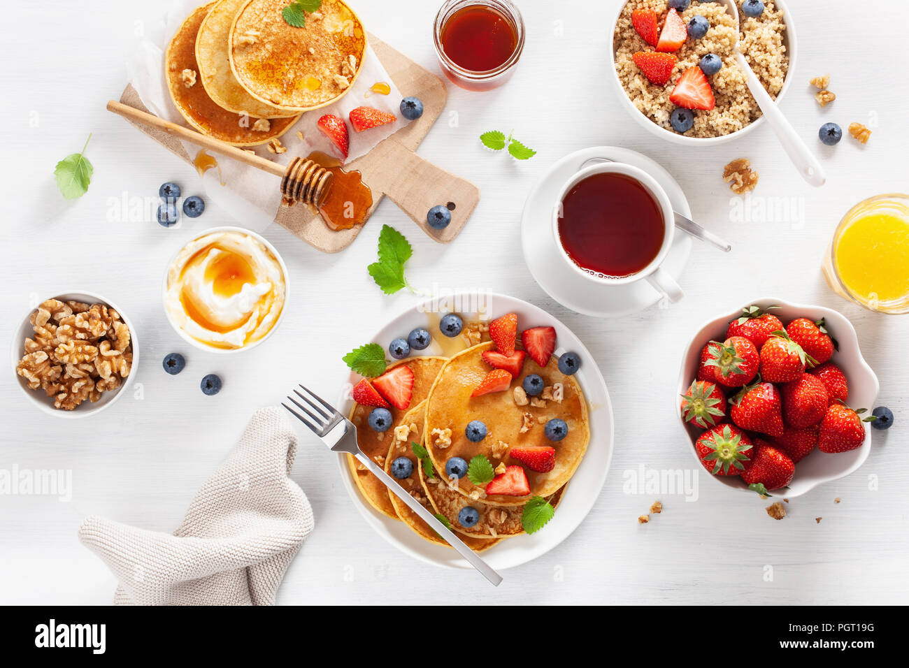 pancakes with blueberry strawberry honey and quinoa for breakfast Stock Photo