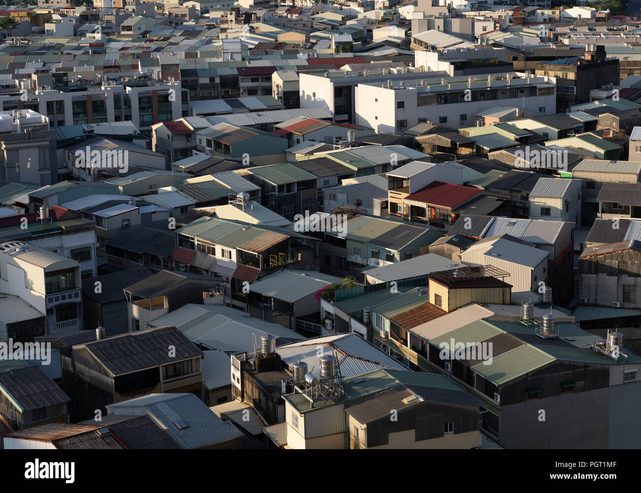 A sprawl of older low houses in Tainan in Southern Taiwan early in the morning - Stock Image