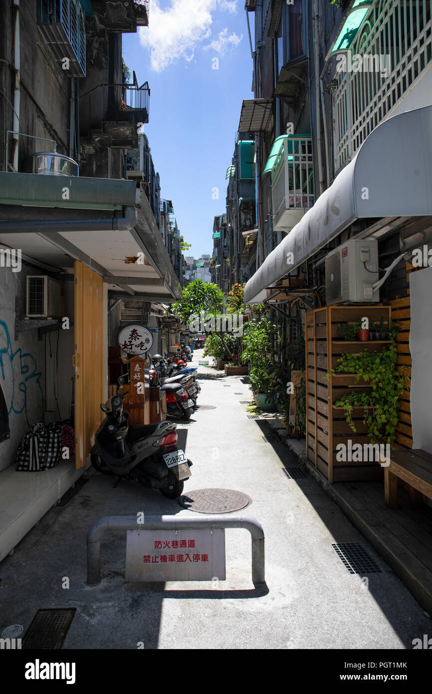 """Fire lane on a residential Taipei backstreet with sign reading """"Fire lane. Parking scooters and motorcycles prohibited.' - Stock Image"""