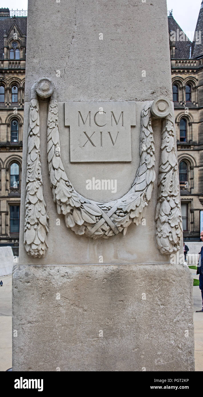 Detail of one of the obelisks flanking central cenotaph of Manchester England war memorial showing garland of leaves and inscription MCMXIV Stock Photo