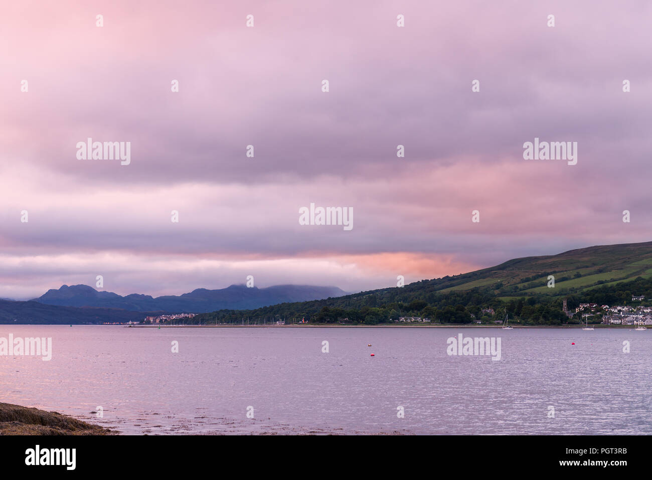 Purple Sunset at the Gare Loch or Gareloch (Gaelic: An Gearr Loch) is a sea loch in Argyll and Bute, Scotland, UK - Stock Image