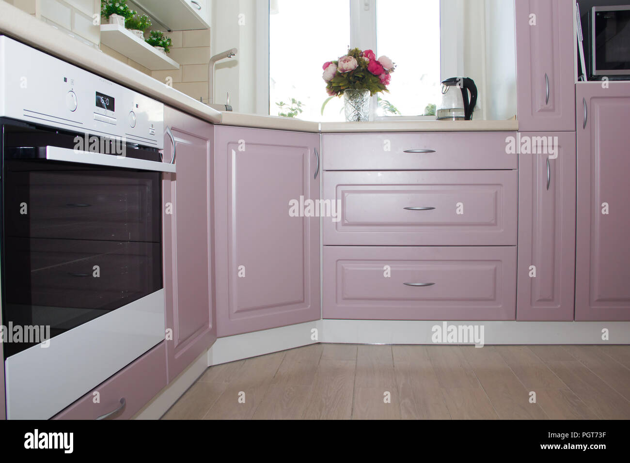 4621ff2acfbd Large light pink kitchen. Interior of a pink kitchen. Wooden Kitchen  Design. Russia, St. Petersburg, June 2018