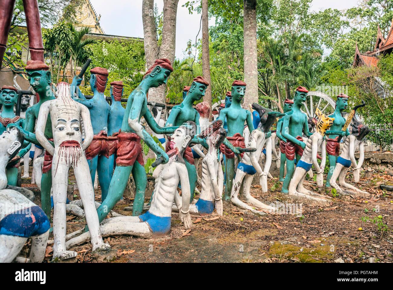 Buddhist religious sculpure yard, showing torture scences at Wat Chaiyaphum Phithak, Thailand   Buddhistische Skulpturen und Darstellung von grausamen - Stock Image