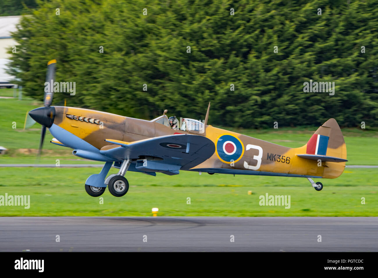 RAF BBMF Supermarine Spitfire fighter aircraft taking off from Dunsfold Aerodrome, UK during the Wings & Wheels Airshow on the 25th August 2018. - Stock Image