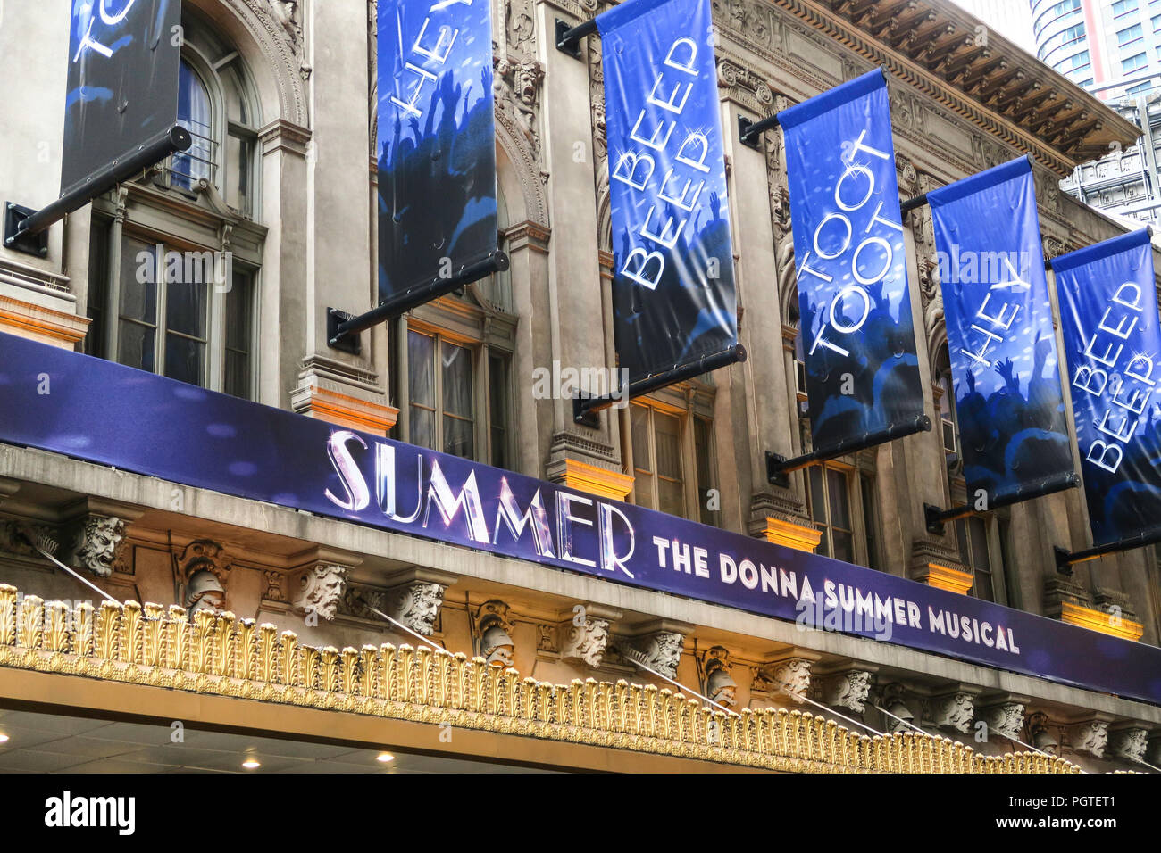 Signs and banners on the Donna Sumner Musical Theater Facade, Times Square, NYC, USA - Stock Image