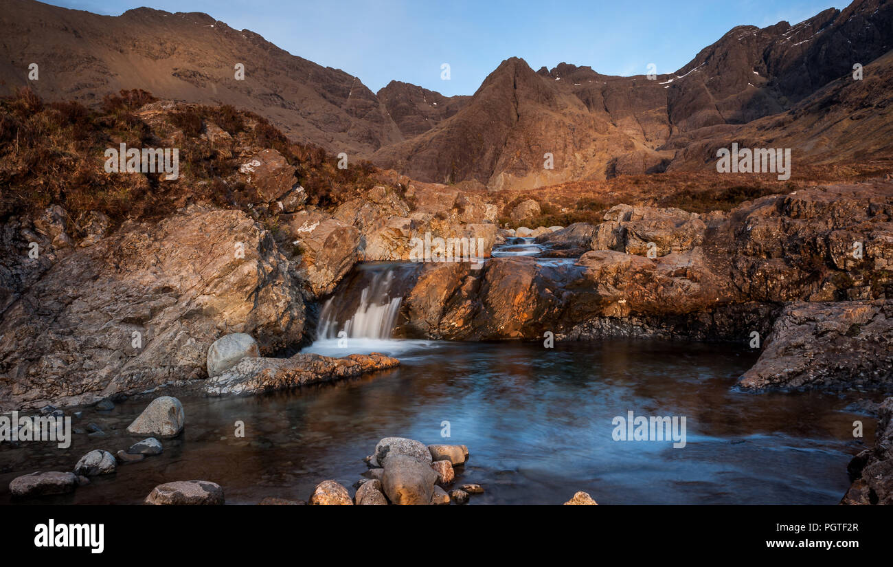 Located in Glen Brittle on the Isle of Skye lies the Fairy Pools a popular tourist attraction with the Cuillin Ridge in the background - Stock Image