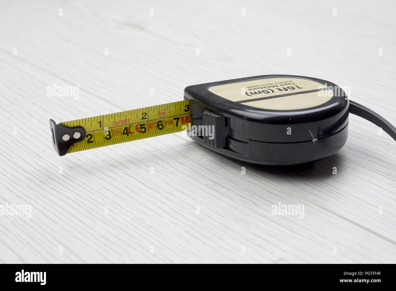 Tape measure, retractable,in metric and imperial measuremnts - Stock Image