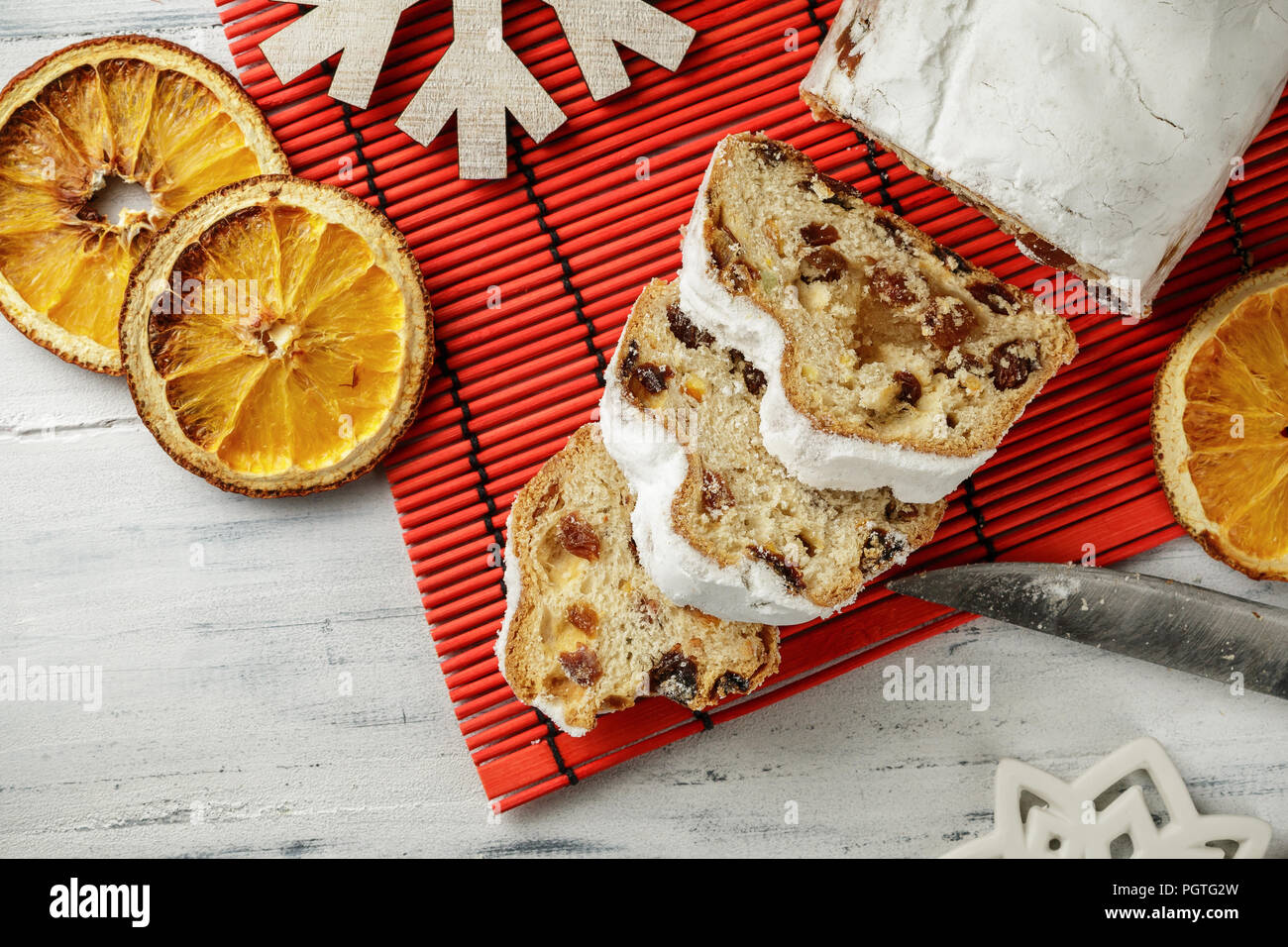 Stollen, traditional German Christmas yeast cake with raisins on the table, top view - Stock Image