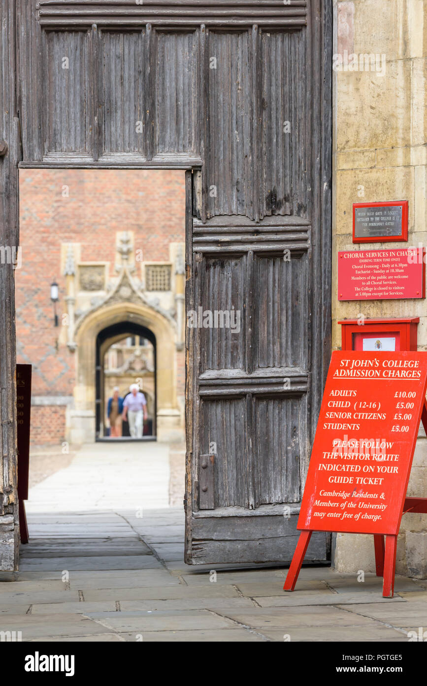 Notice board by the main entrance to St John's college, university of Cambridge, England, informing of admission charges. - Stock Image