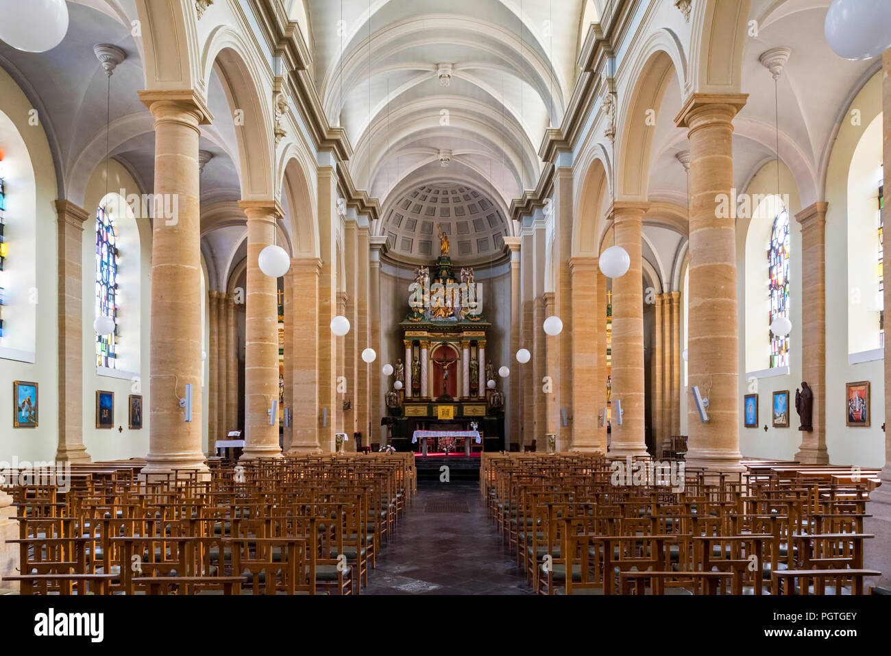 The Neoclassical Saint Peter and Paul's church / Église Saints-Pierre-et-Paul in the city Bouillon, Luxembourg Province, Belgian Ardennes, Belgium - Stock Image
