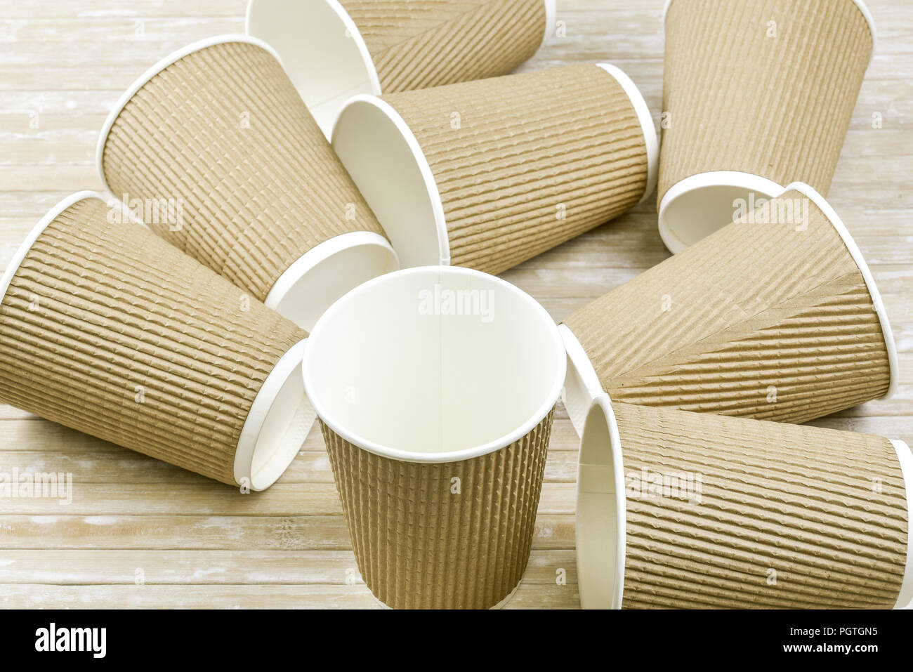 Brown cardboard take away disposable paper cups with white