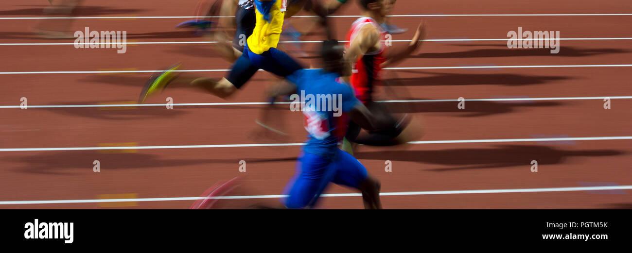 running men sprinters runners in 100 meters blurred motion - Stock Image