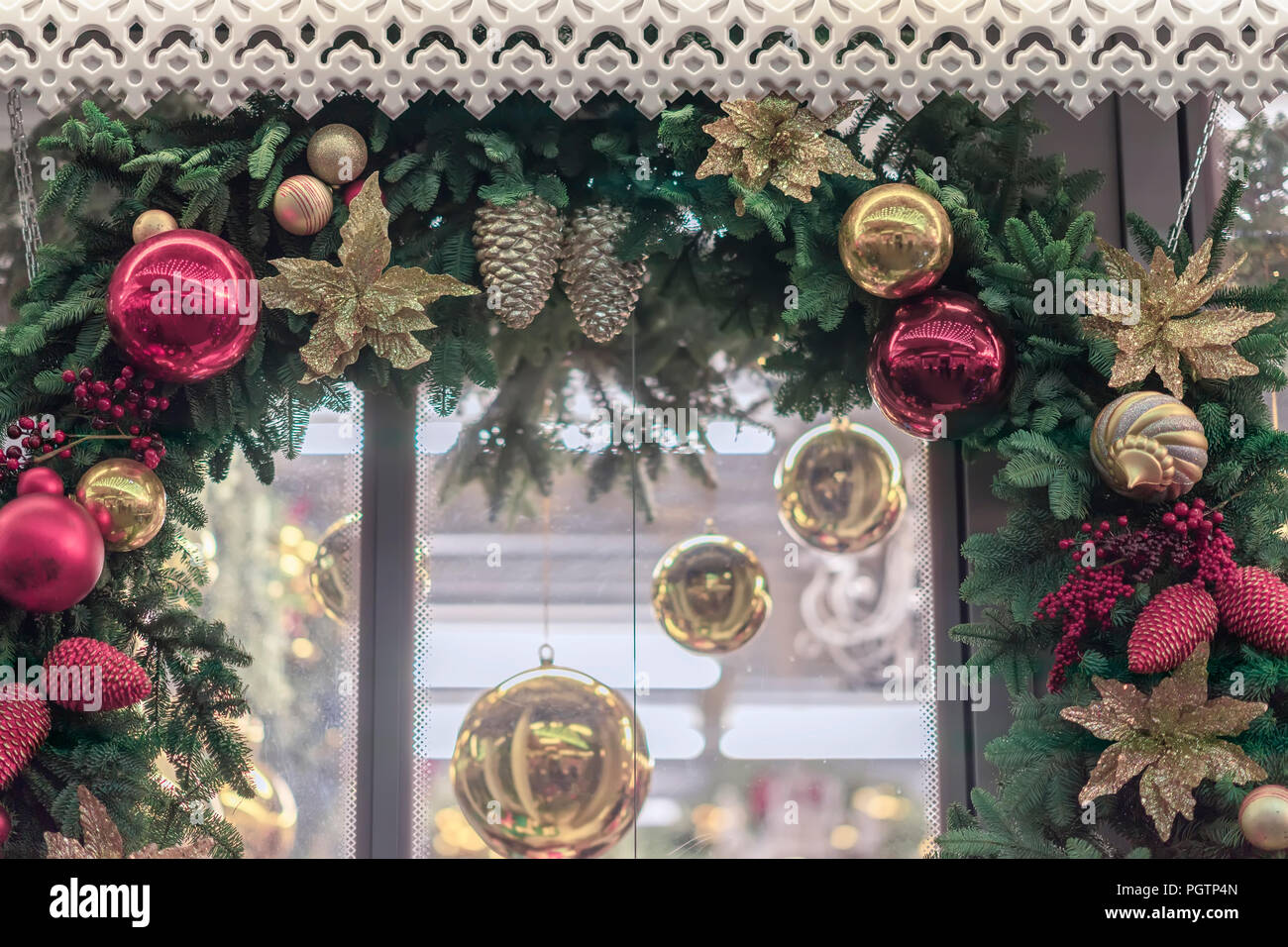 christmas garland a wreath close up around a window with shiny decorations balls cones berries festive background winter holiday happy new year xmas