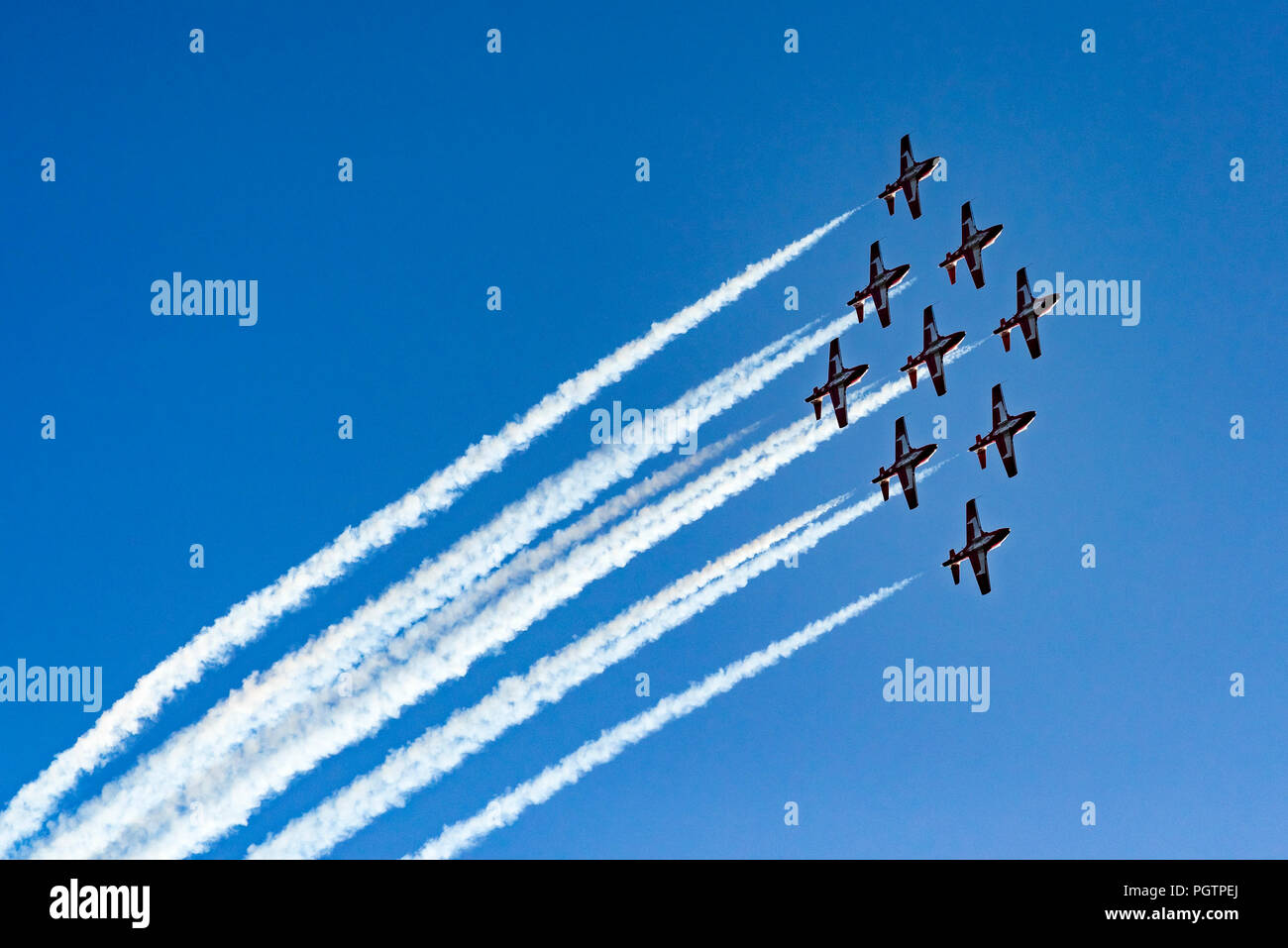 Canadian Forces (CF) Snowbirds, 431 Air Demonstration Squadron fly over Vancouver, British Columbia, Canada - Stock Image