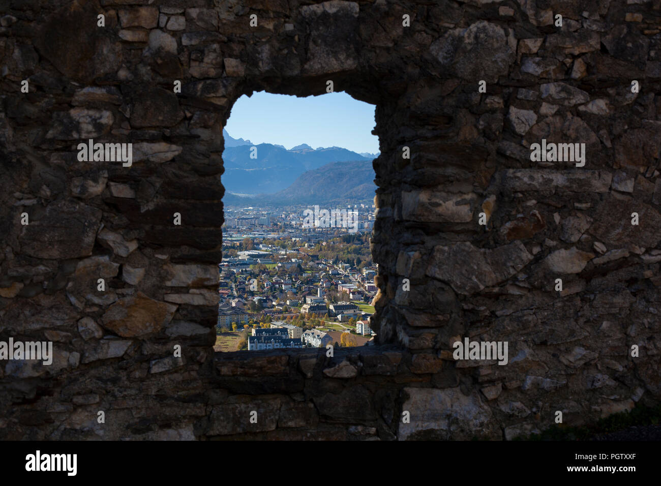 A view to the city of Villach throug the window of Burg Landskron castle Stock Photo