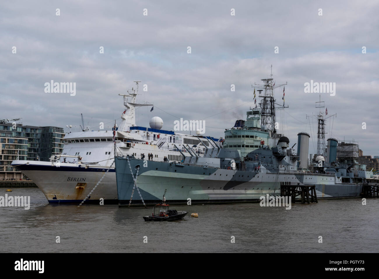 FTI cruises cruise ship MS Berlin alongside HMS Belfast in central London. - Stock Image