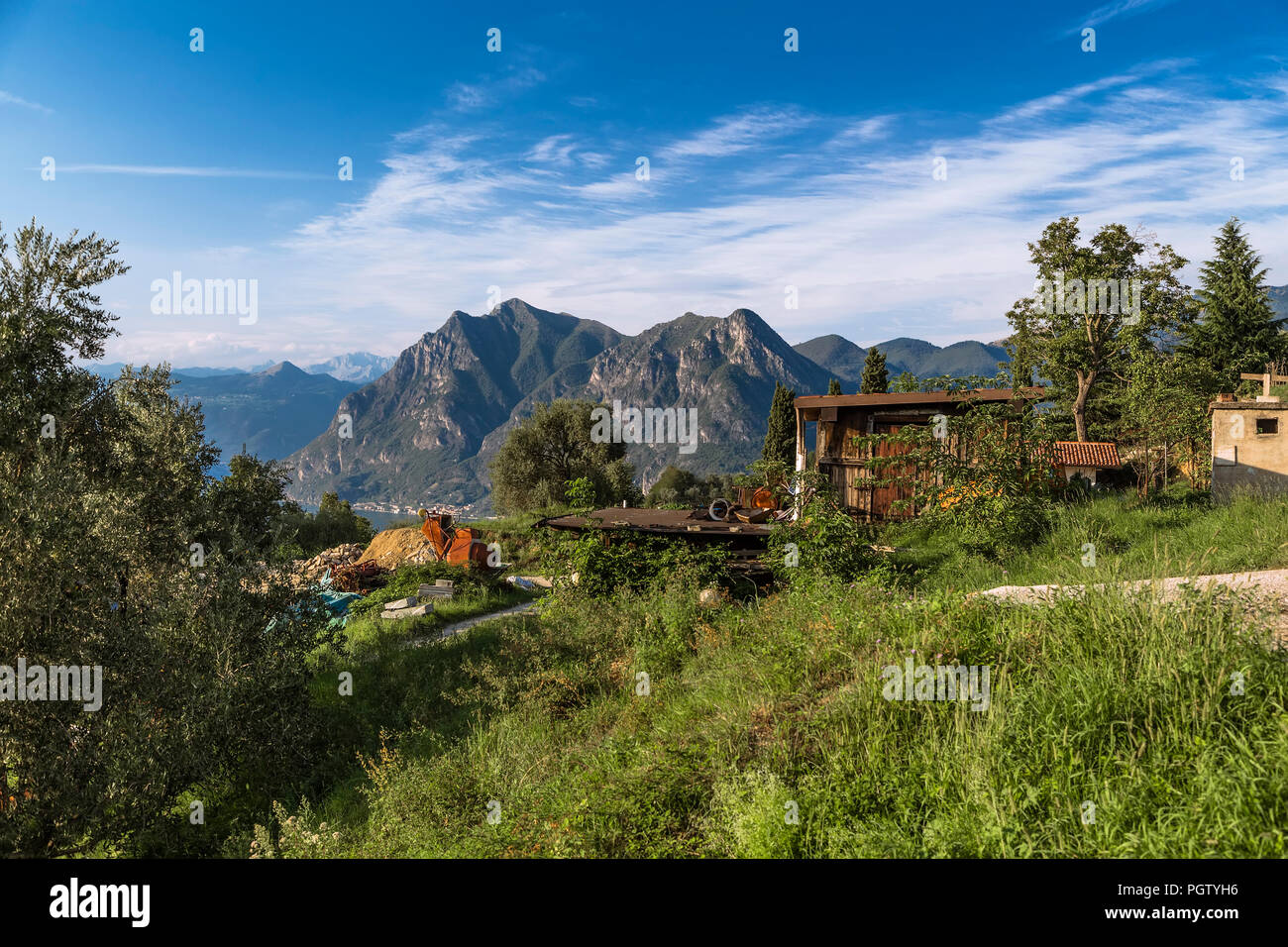 Rural Italian landscape on Lake Iseo and the mountains on the horizon. Italy - Stock Image