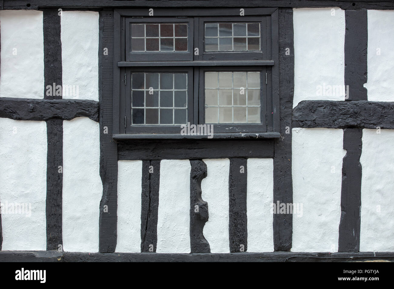 Simple horizontal and vertical black lines of half timber house with window in the old part of Hastings on the south coast of England, East Sussex. - Stock Image