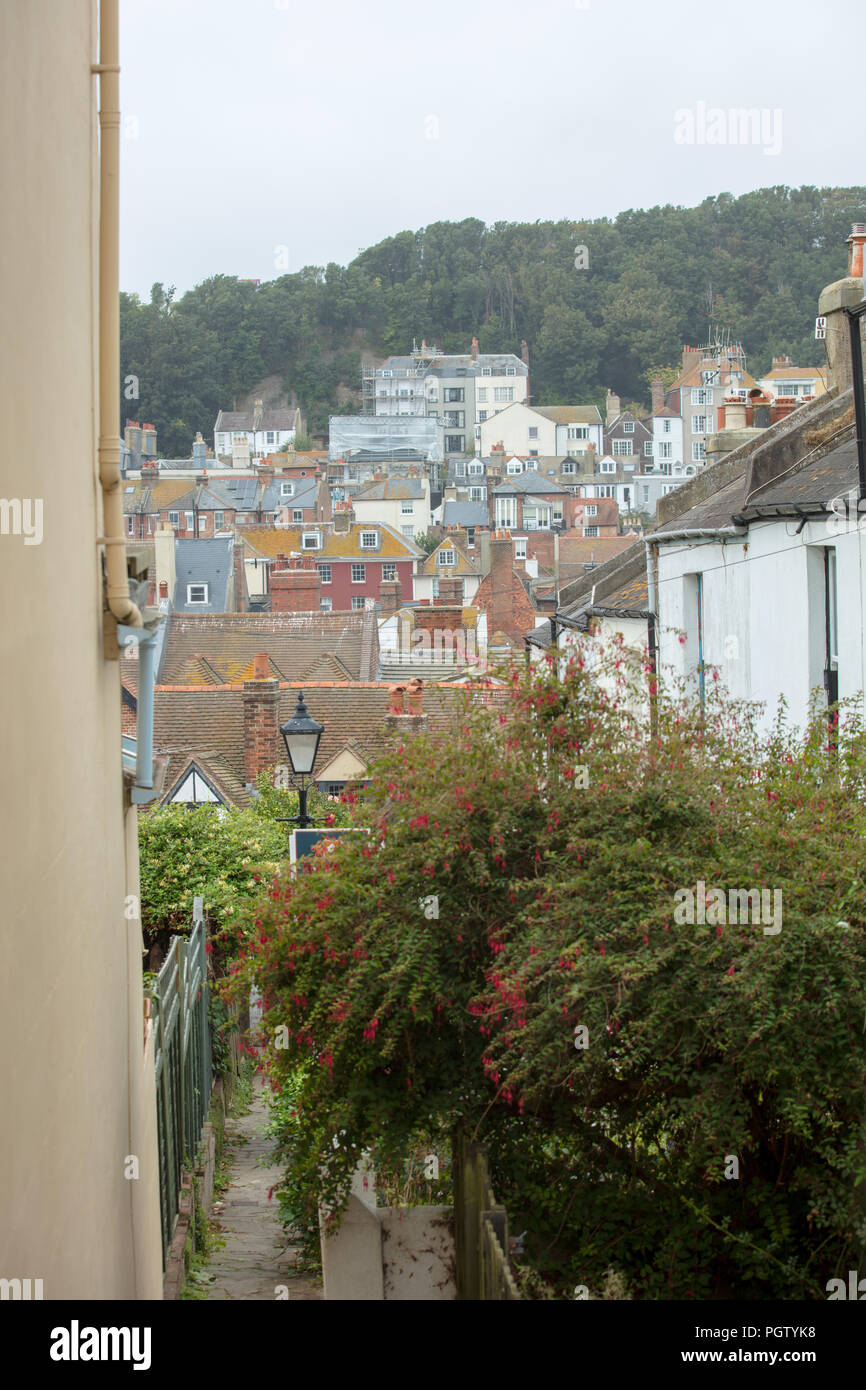 View from one of the small streets in old Hastings, looking onto a large part of this town with its rich variety in types of houses and buildings. - Stock Image