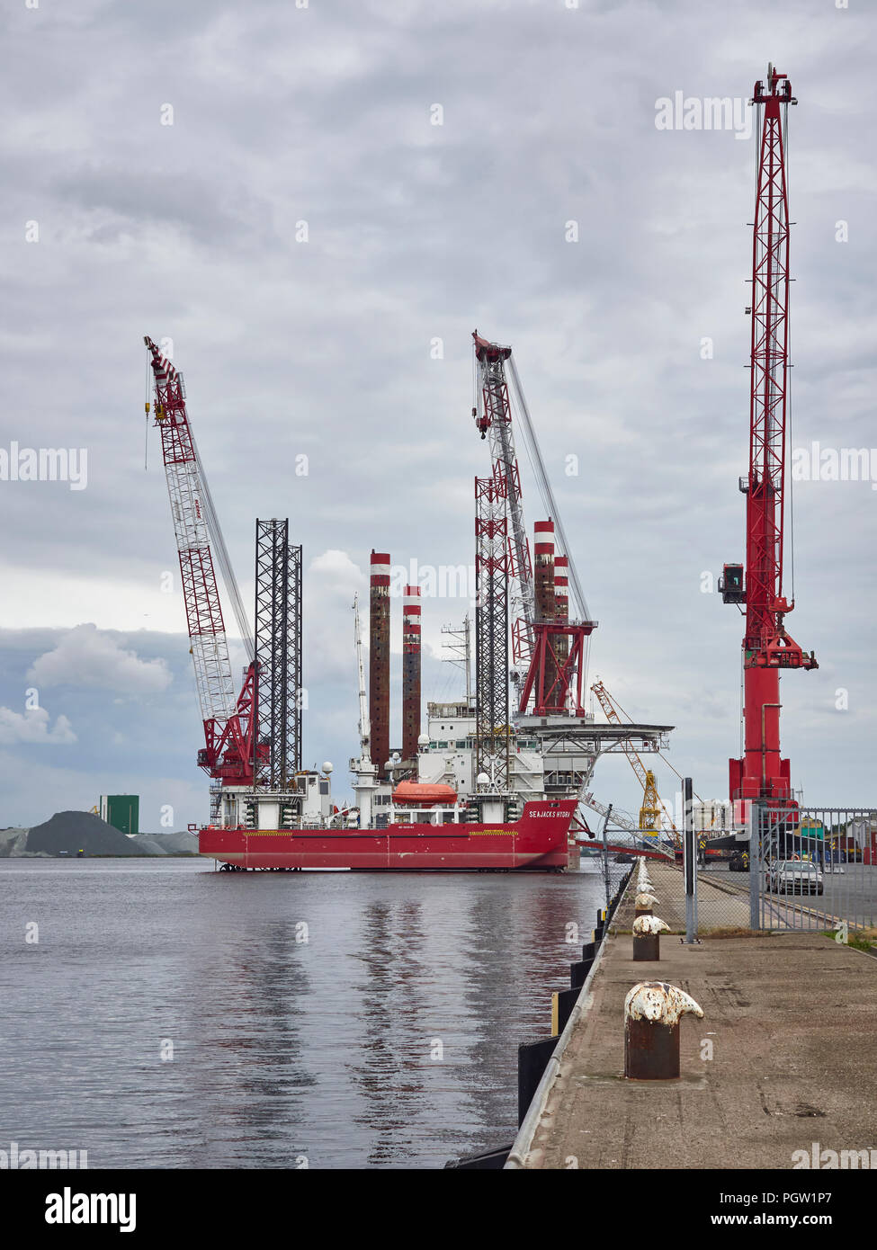 The Seajacks Hydra, a self Propelled multipurpose Jack Up Barge moored alongside Den Haag Container Port in Amsterdam. - Stock Image