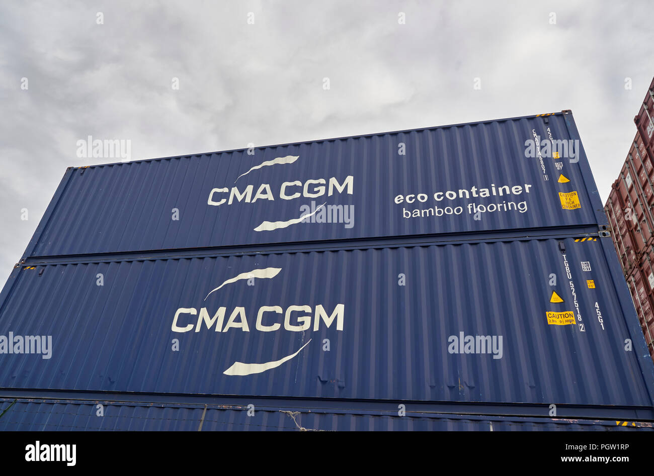 Close up of some Blue CMA CGM Eco Shipping Containers stacked up in Den Haag ready for Shipping somewhere. The Netherlands. - Stock Image