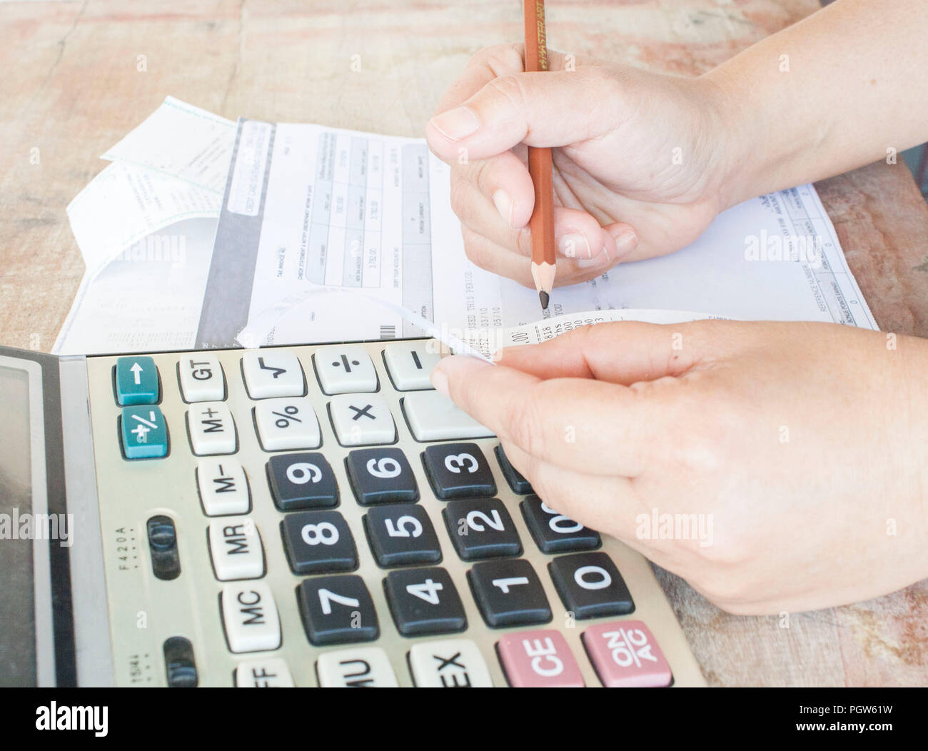 document  money and calculator for check control expense - Stock Image