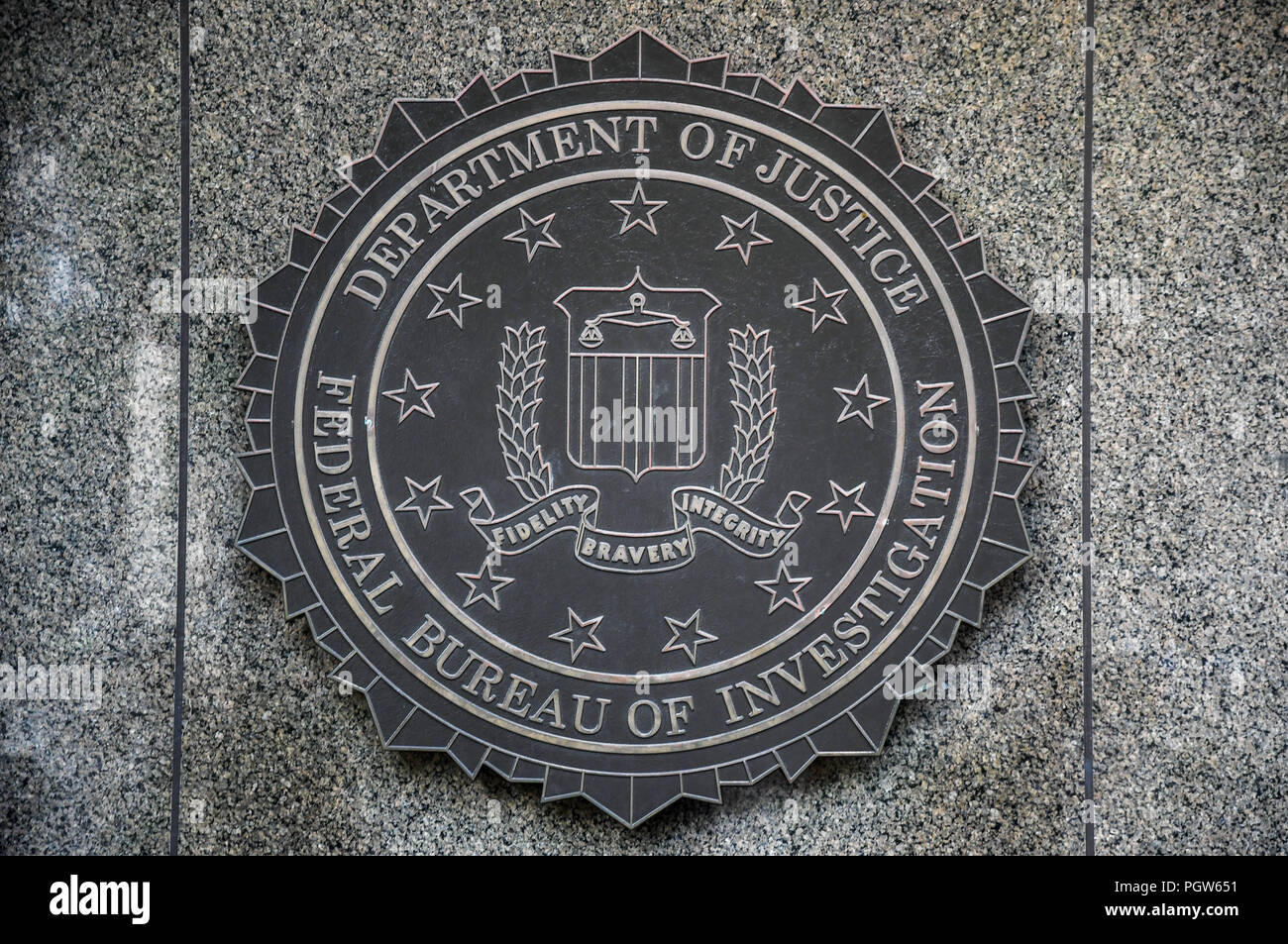 Seal of the federal bureau of investigation on a wall at the j