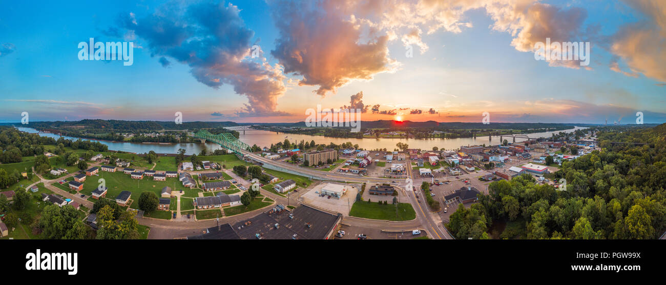 A full aerial panoramic view of Point Pleasant, West Virginia, with the Ohio, Kanawha River and bridges with the sun setting over the town. - Stock Image