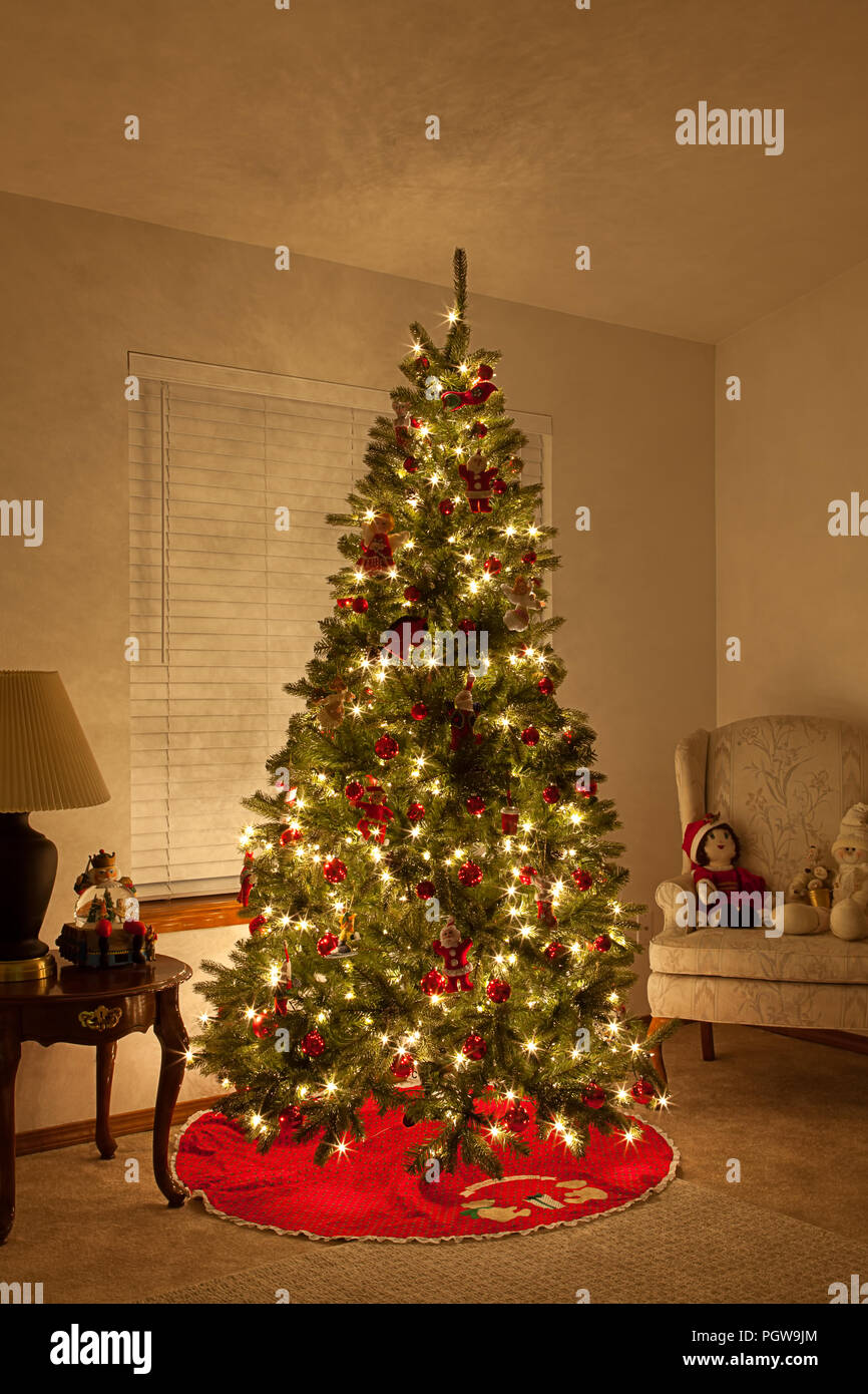 christmas tree with white lights and red bulbs in living room