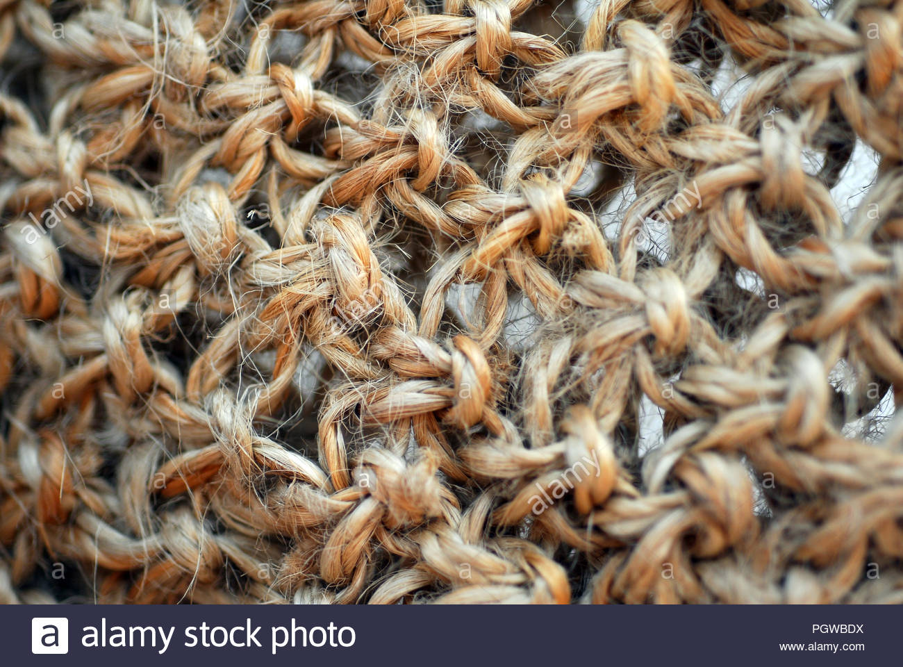 an isolated shot of brown jute texture background - Stock Image