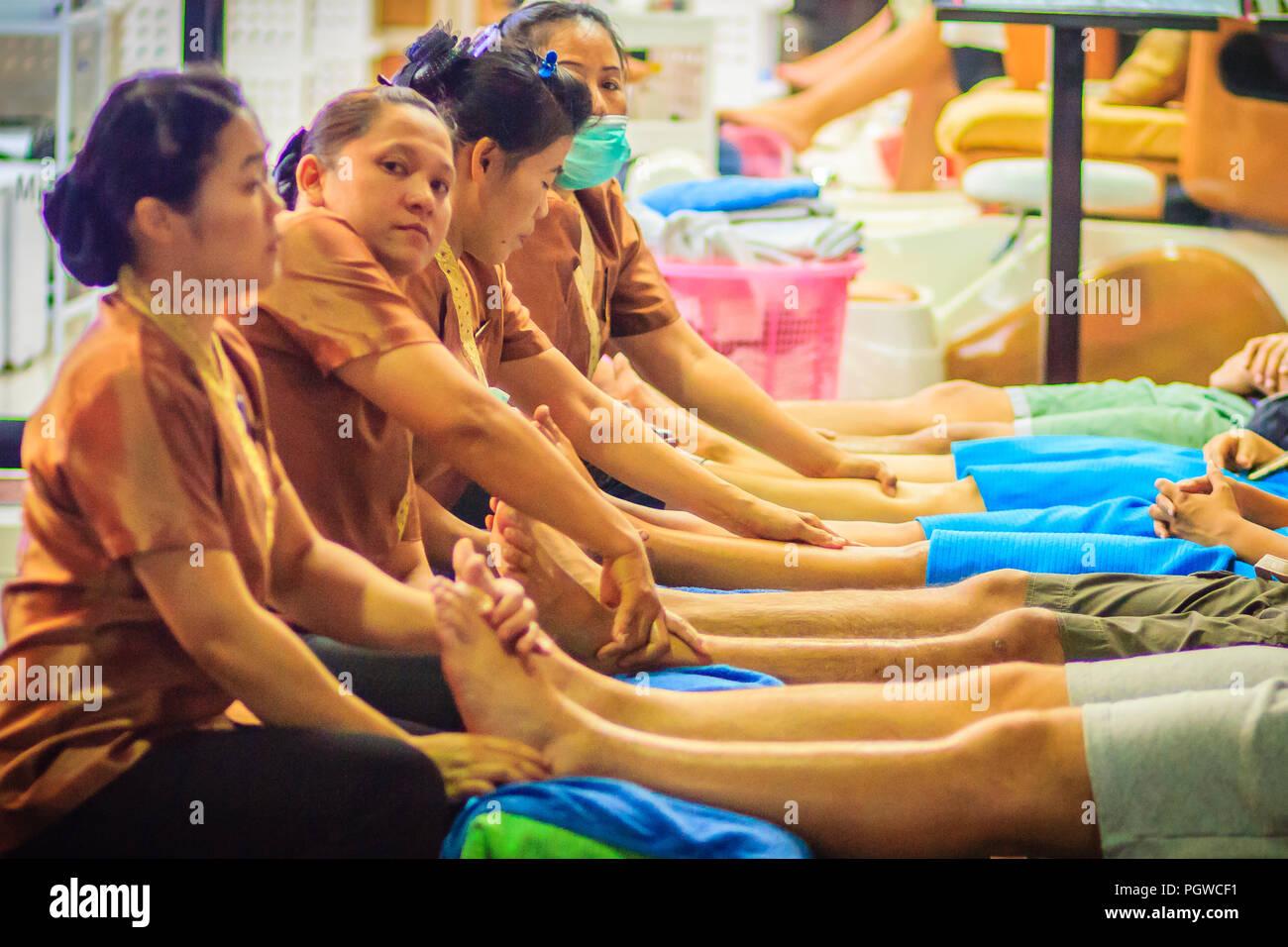 Bangkok, Thailand - March 2, 2017:  Foot massage service in spa salon at Khao San Road night market, Bangkok, Thailand. Stock Photo