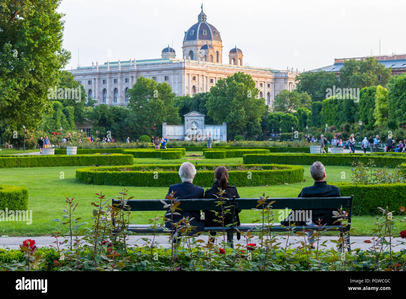 People Sitting In Public Park On Sunny Day Stock Photos