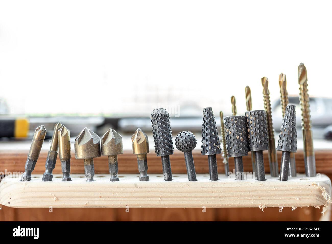 Close-up woodwork tool set. Rasp-file burr countersink kit. Carpentry woodworking workshop concept. - Stock Image