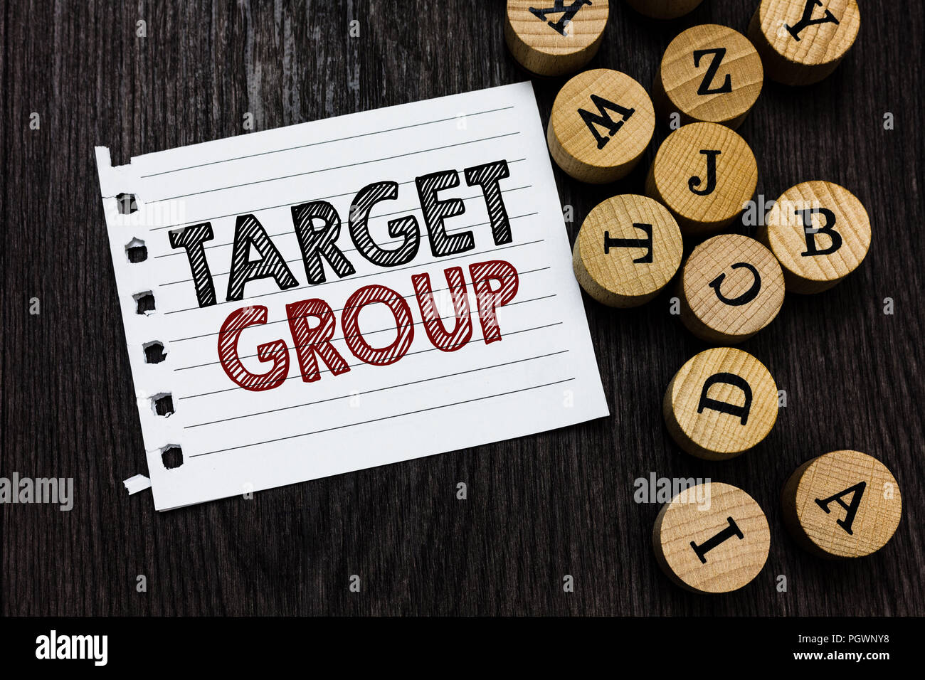 word writing text target group business concept for particular people that an advertisement intended to reach to piece notebook paper circle letters
