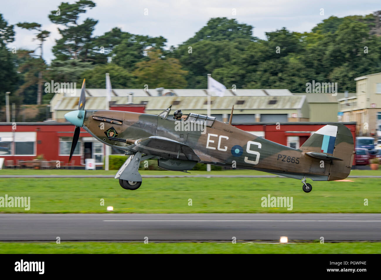 RAF BBMF Hawker Hurricane fighter aircraft taking off from Dunsfold Aerodrome, UK during the Wings & Wheels Airshow on the 25th August 2018. - Stock Image