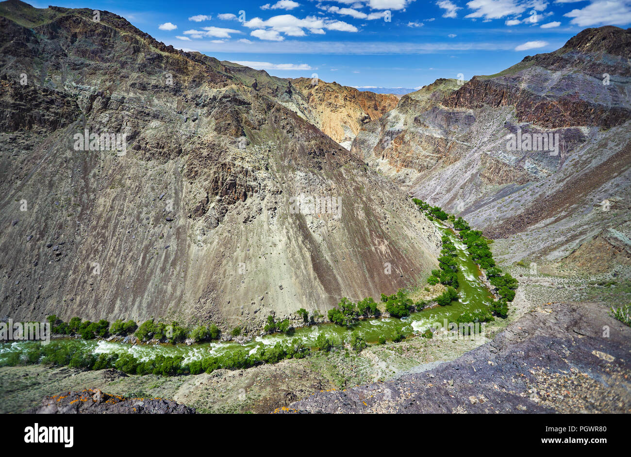 Aerial shot of river Charyn in canyon at mountain background in Kazakhsthan - Stock Image