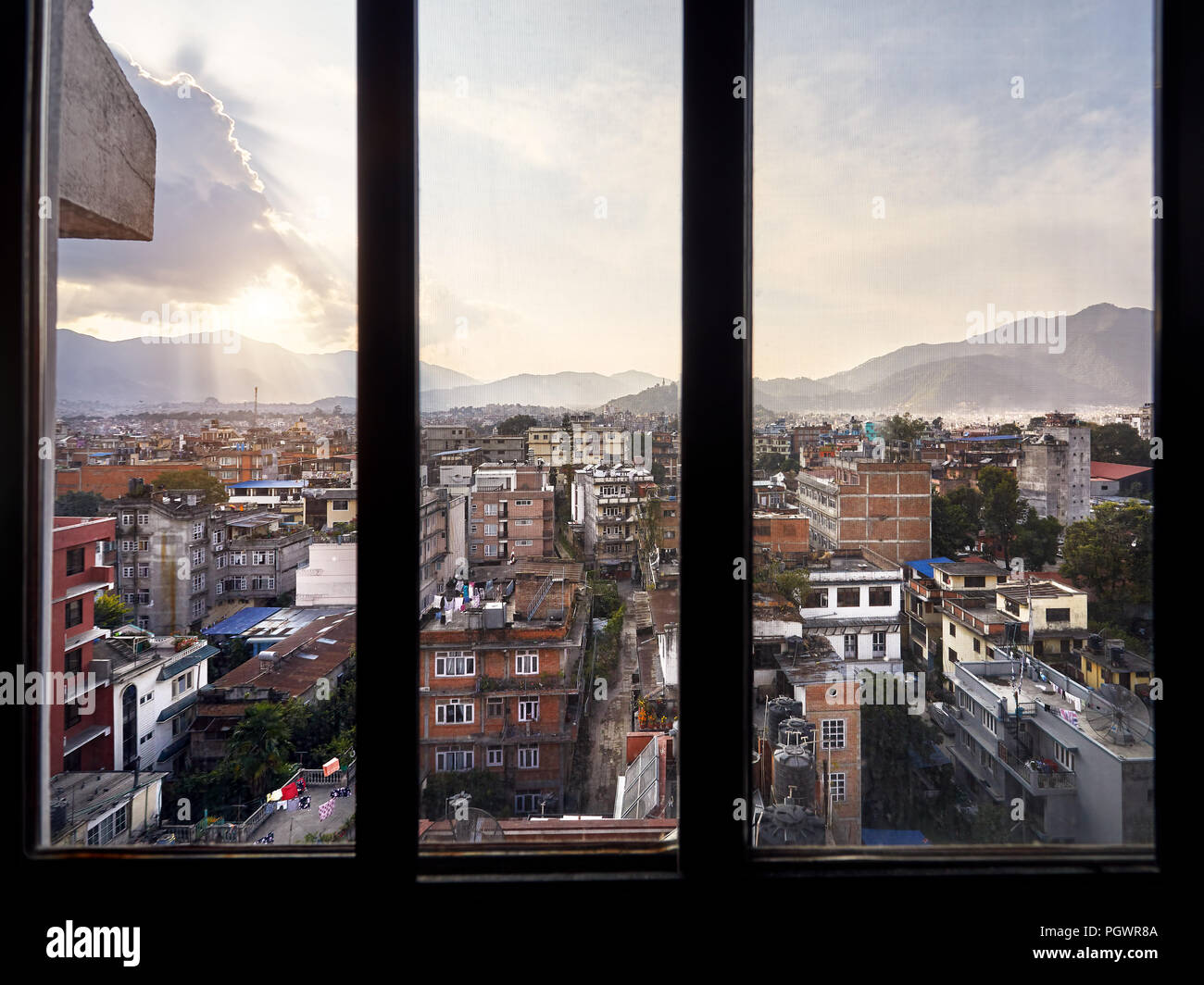 Beautiful view of Kathmandu the capital of Nepal from the window of guest house at sunset - Stock Image