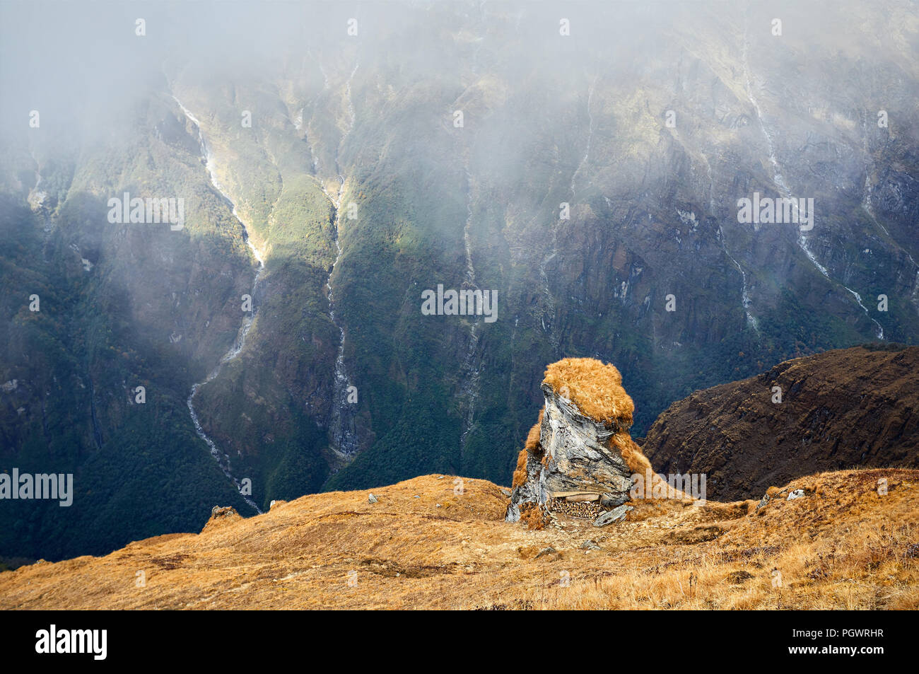 Landscape of Rocks and Waterfalls at foggy day in Himalaya Mountains in Nepal - Stock Image