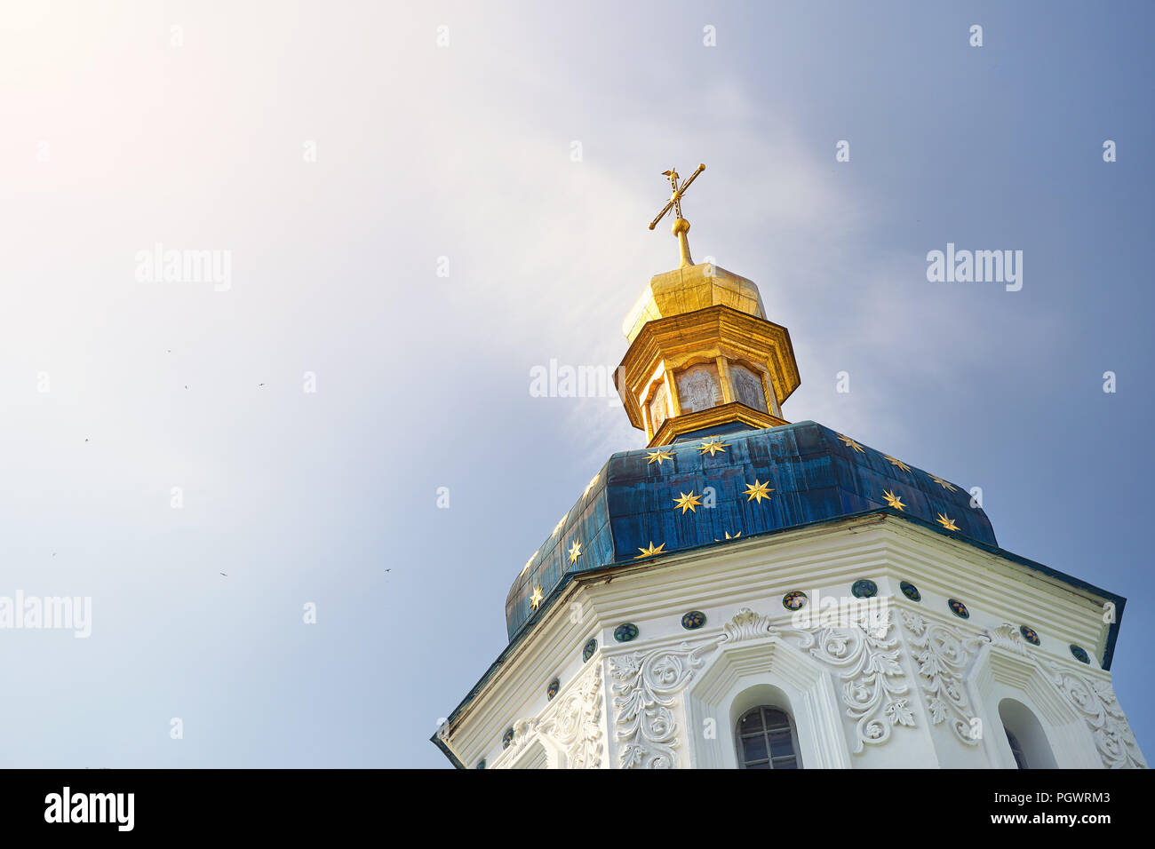 Blue dome with stars and golden cross of Kiev Pechersk Lavra. Old historical architecture in Kiev, Ukraine - Stock Image