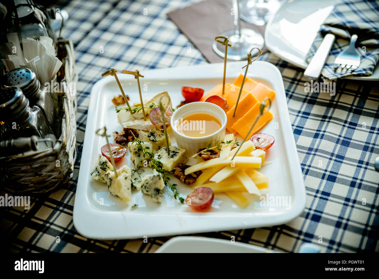 Cheese Plate Assortment Of Various Types Of Cheese And Honey On White Plate Cheese And Wine Party Table Perfect Holiday Appetizer Different Types Of Cheeses Raw Food Concept Stock Photo Alamy