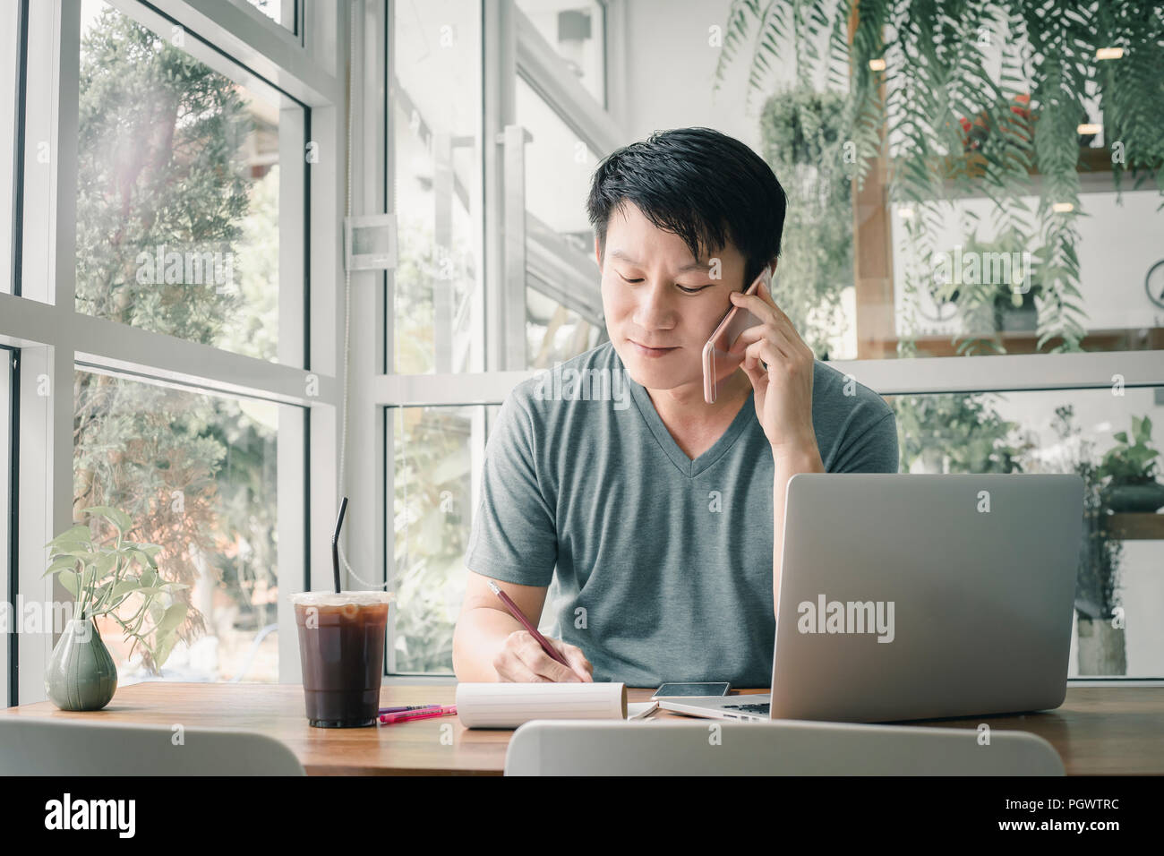 Freelancer man working online at his home. - Stock Image