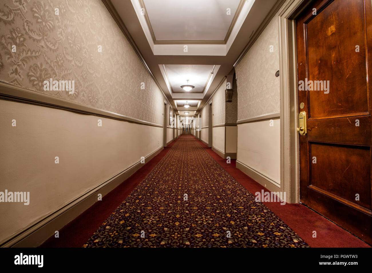 Hallway inside the famed Stanley Hotel in Estes Park, Colorado. The Hotel was noted to be the inspiration for Stephen King's novel 'The Shining' - Stock Image