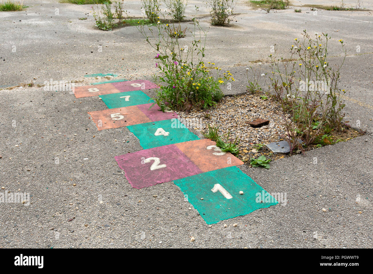 A hopscotch game in a disused school playground - Stock Image