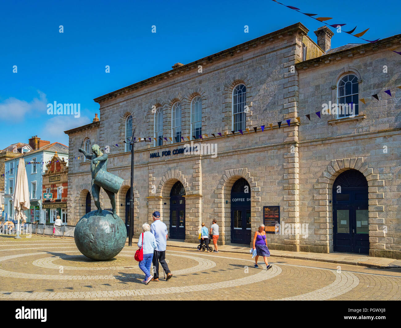 12 June 2018: Truro, Cornwall, UK - The Hall for Cornwall, a major venue in the city, and sculpture 'The Drummer' by Tim Shaw. - Stock Image